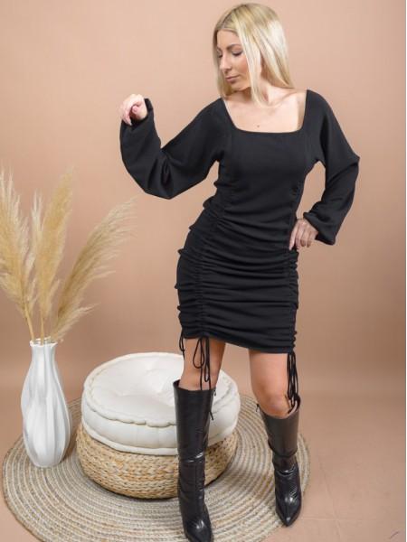 Μαύρο μακρυμάνικο πλεκτό midi φόρεμα με τετράγωνη λαιμόκοψη, λάστιχα στις μανσέτες και ρυθμιζόμενες σούρες μπροστά και πίσω που το μετατρέπουν σε κοντό Combos