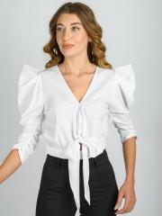 Λευκή μπλούζα σε βαμβακοσατέν ύφασμα με πιέτες και σούρα στο μανίκι, κλείσιμο με κόμπο μπροστά και λάστιχο στο τελείωμα We coss