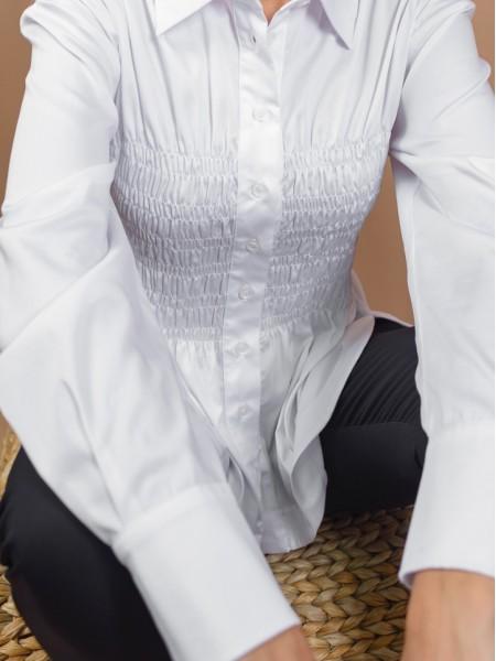 Λευκό μακρυμάνικο βαμβακοσατέν πουκάμισο με σφηκοφωλιά στην μέση, ρεγκλάν μανικοκόλληση και στρογγυλεμένα ανοίγματα στο πλάι Access