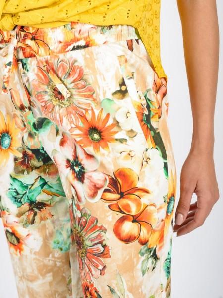 Εμπριμέ πορτοκαλί ψηλόμεσο cropped παντελόνι με λάστιχο στη μέση, κορδόνι με τούνελ, πλαϊνές τσέπες και ρεβέρ στο τελείωμα Vener